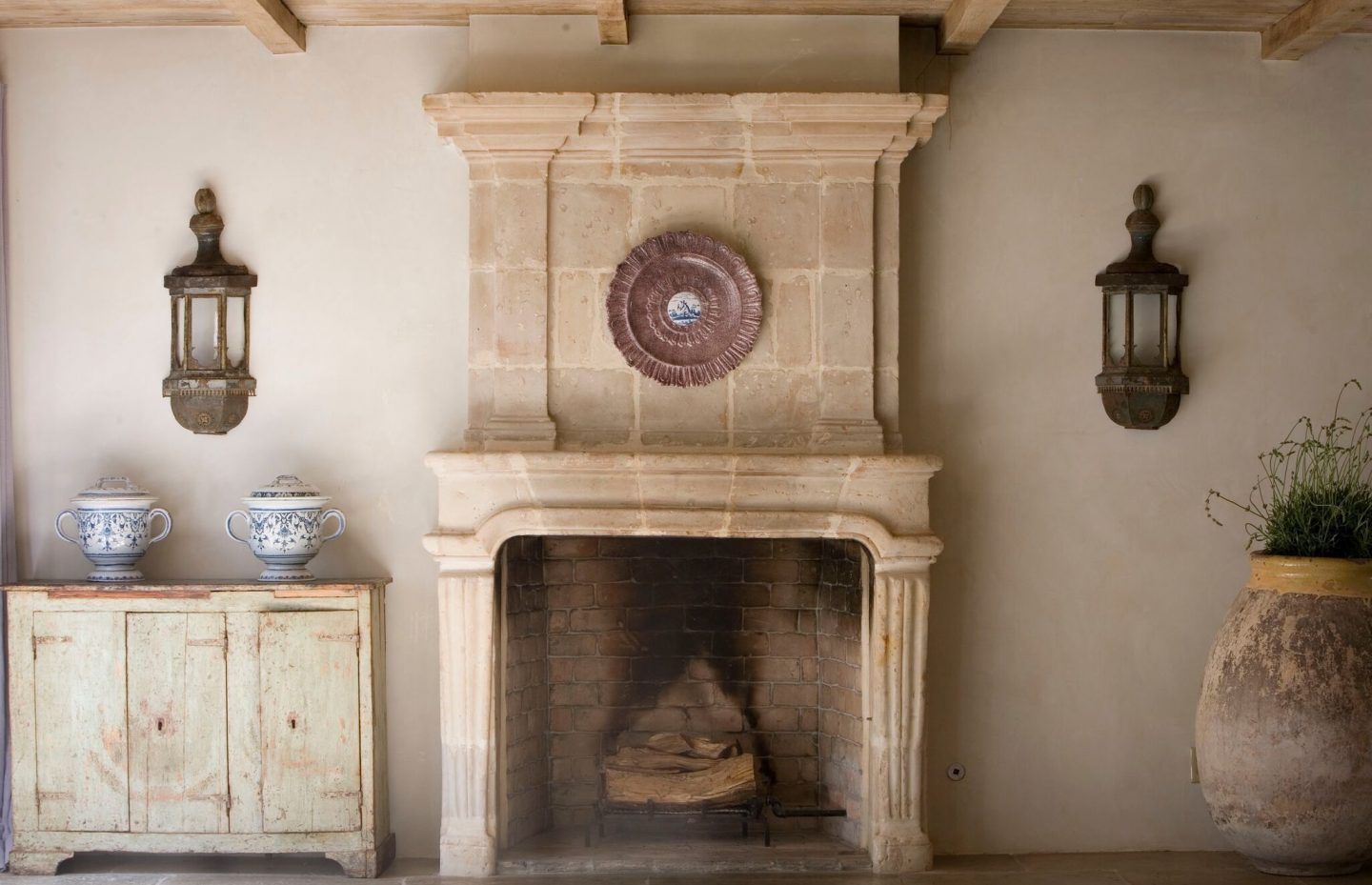 Chateau Domingue Timeless European Elegance and French farmhouse style converge in this house tour of founder Ruth Gay's home on Hello Lovely. Reclaimed stone, antique doors and mantels, and one of a kind architectural elements. #housetour #frenchcountry #frenchfarmhouse #europeanfarmhouse #chateaudomingue #rusticdecor #pamelapierce #elegantdecor #diningroom #fireplace