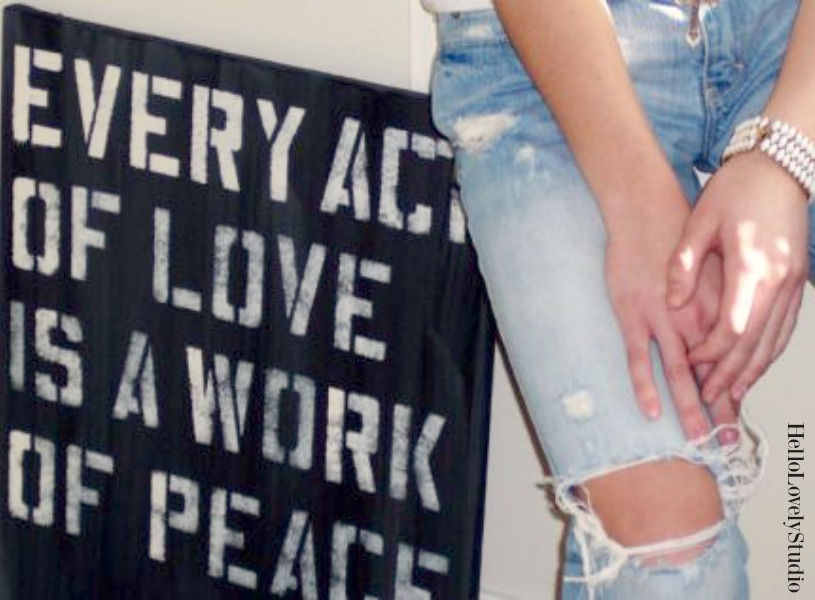 Hello Lovely Studio painting with Mother Teresa quote (Every act of love is a work of peace) and model with distressed ripped jeans. #hellolovelystudio #art #motherteresa #beachy #rippedjeans