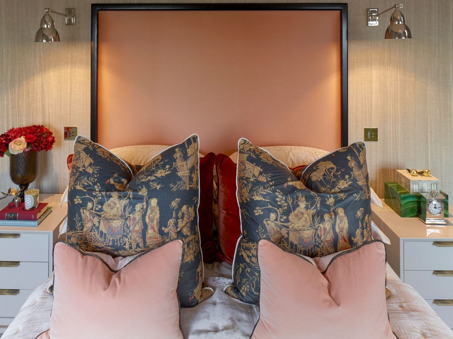 Peach headboard in in London apartment. Colorful Classic Decor in London Inspired by 'Out of Africa' - come see more from Studio L London! #britishcolornial #livingroom #pinkandgreen #elegantdecor #Londonapartment #interiordesigninspiration
