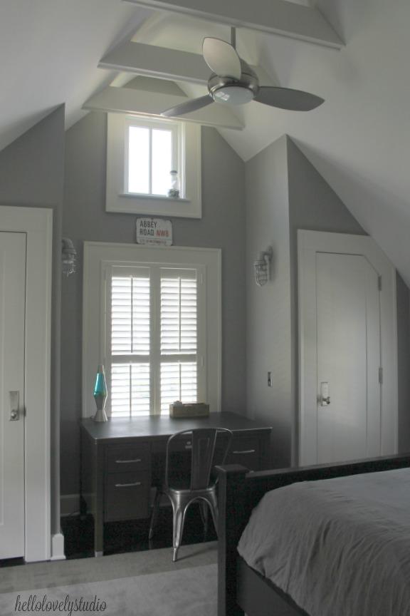 Boys farmhouse bedroom inspiration with grey walls and white trim. Modern Industrial Farmhouse Bedroom Design {2nd Floor Tour}. #modernfarmhouse #bedroom #industrialfarmhouse #greywalls #luxuriousfarmhouse #benjaminmooreplatinum #benjaminmoorestoningtongray