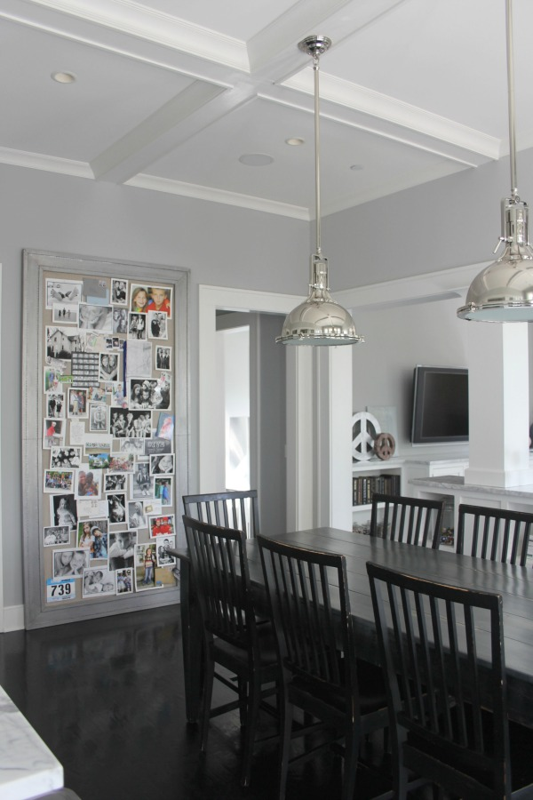 Breakfast dining nook in a modern farmhouse with black hardwood floors and Stonington Gray wall color.