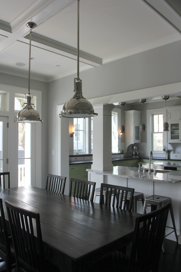 Industrial Chic Farmhouse Kitchen Inspiration with green cabinets, custom stainless island, and black stained flooring. #modernfarmhouse #kitchendesign #industrialfarmhouse #farmhousekitchen #benjaminmoorestoningtongray