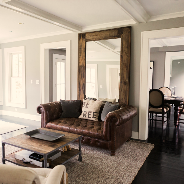 Benjamin Moore Platinum Gray paint on walls of modern farmhouse living room with tufted leather Chesterfield sofa. Time to Paint Your Walls? Come discover a Refresher to Demystify the Process!