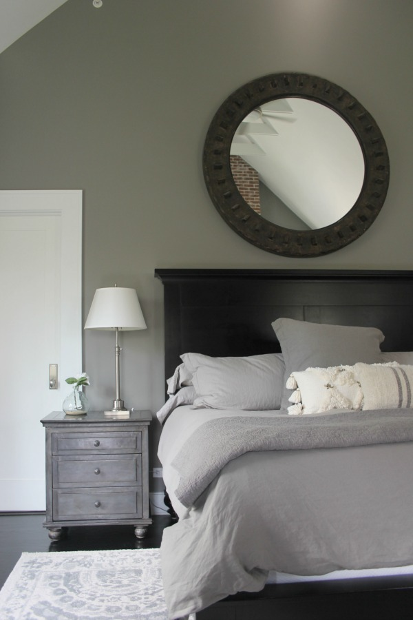 Bedroom with black furniture and Benjamin Moore Stonington Gray painted walls. Hello Lovely Studio.