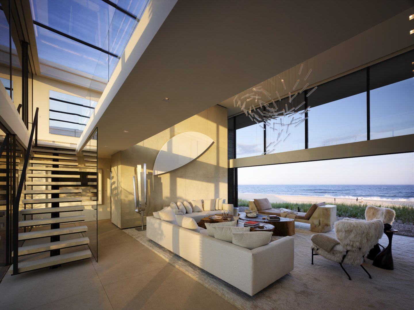 Modern living room of oceanfront home. A wall of glass rises in the air to eliminate any separation from the outdoors. #beachhouse #oceanfront #housedesign #livingroom #modernarchitecture