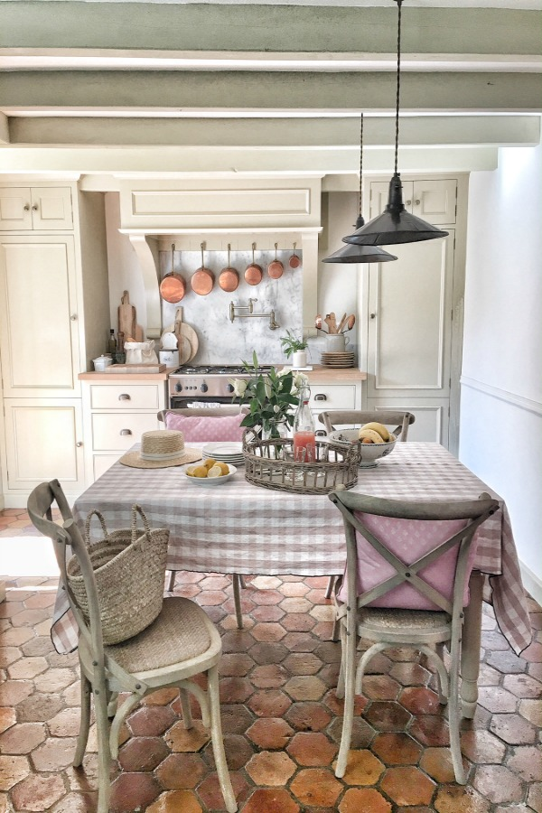 Terracotta hexagon tiles in a kitchen in France. French farmhouse design inspiration, house tour, French homewares and market baskets from Vivi et Margot. Photos by Charlotte Reiss. Come be inspired on Hello Lovely and learn the paint colors used in these beautiful authentic French country interiors. #frenchfarmhouse #hellolovelystudio #frenchcountry #designinspiration #interiordesign #housetour #vivietmargot #rusticdecor #frenchhome #authentic #neptune #farrowandballfrenchgray #kitchendesign #frenchmarket #summerliving #bordeaux #westernfrance #europeanfarmhouse