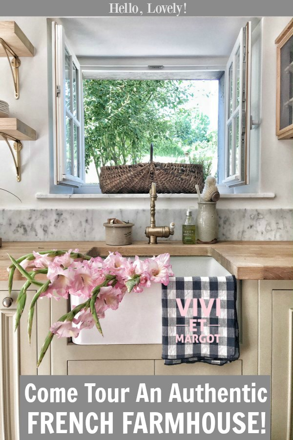 A renovated kitchen in a 150 year old country house in France has charming windows at the farm sink. #vivietmargot #kitchendesign #frenchfarmhouse #rusticdecor #farmsink