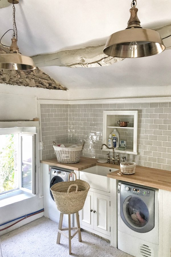 Farmhouse style laundry room with grey subway tile and farm sink. #frenchcountry #vivietmargot #laundryroom #romanticdecor #farmhousedecor