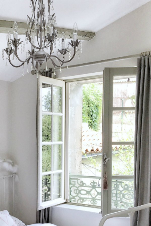 Dtail of window in girls bedroom in France. Enjoy this house tour and ideas to get a rustic European country look!