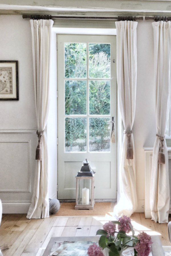 Belgian linen draperies in a French country living room. #frenchhome #livingroom #drapery #frenchfarmhouse #interiordesign #vivietmargot
