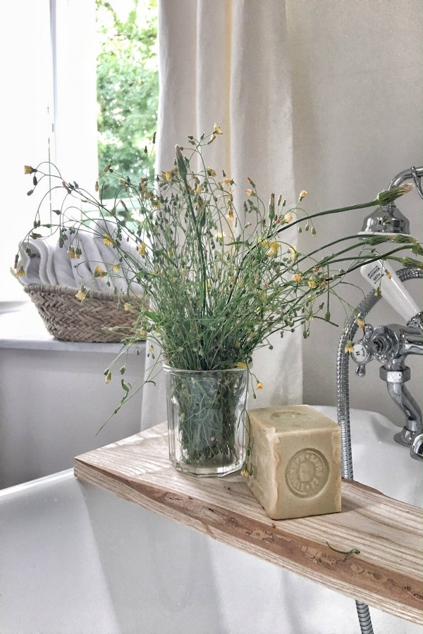 French soap on a clawfoot tub. Beautiful French farmhouse design inspiration, house tour, French homewares and market baskets from Vivi et Margot. Photos by Charlotte Reiss. Come be inspired on Hello Lovely and learn the paint colors used in these beautiful authentic French country interiors. #frenchfarmhouse #hellolovelystudio #frenchcountry #designinspiration #interiordesign #housetour #vivietmargot #rusticdecor #frenchhome #authentic #farrowandballfrenchgray #frenchmarket #summerhouse #europeanfarmhouse