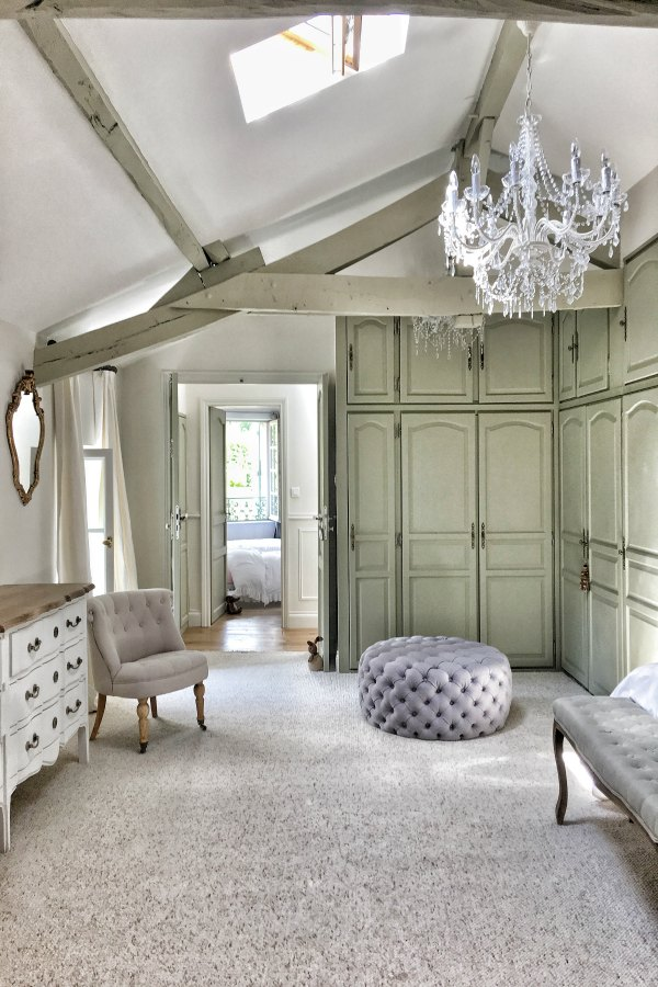 Tranquil, timeless and sophisticated design in a French farmhouse bedroom by Vivi et Margot with Farrow and Ball's Strong White on the walls and French Gray for trim.