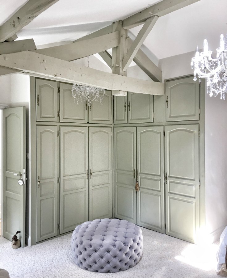 Dressing area in bedroom of a beautiful restored farmhouse in France. Cabinets are painted Farrow & Ball French Gray, and the walls are Strong White. #farrowandballfrenchgray #paintcolors