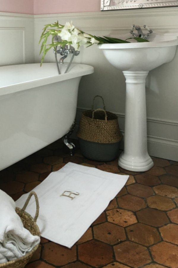 Farrow and Ball Middleton Pink in bathroom.Enjoy this house tour and ideas to get a rustic European country look! #bathroomdesign #terracottatile #farrowandballmiddletonpink