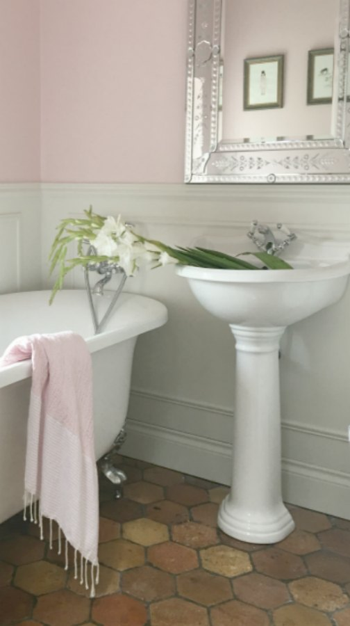 Farrow and Ball Middleton Pink in bathroom. Beautiful French farmhouse design inspiration, house tour, French homewares and market baskets from Vivi et Margot. Photos by Charlotte Reiss. Come be inspired on Hello Lovely and learn the paint colors used in these beautiful authentic French country interiors. #frenchfarmhouse #bathroomdecor #farrowandballmiddletonpink