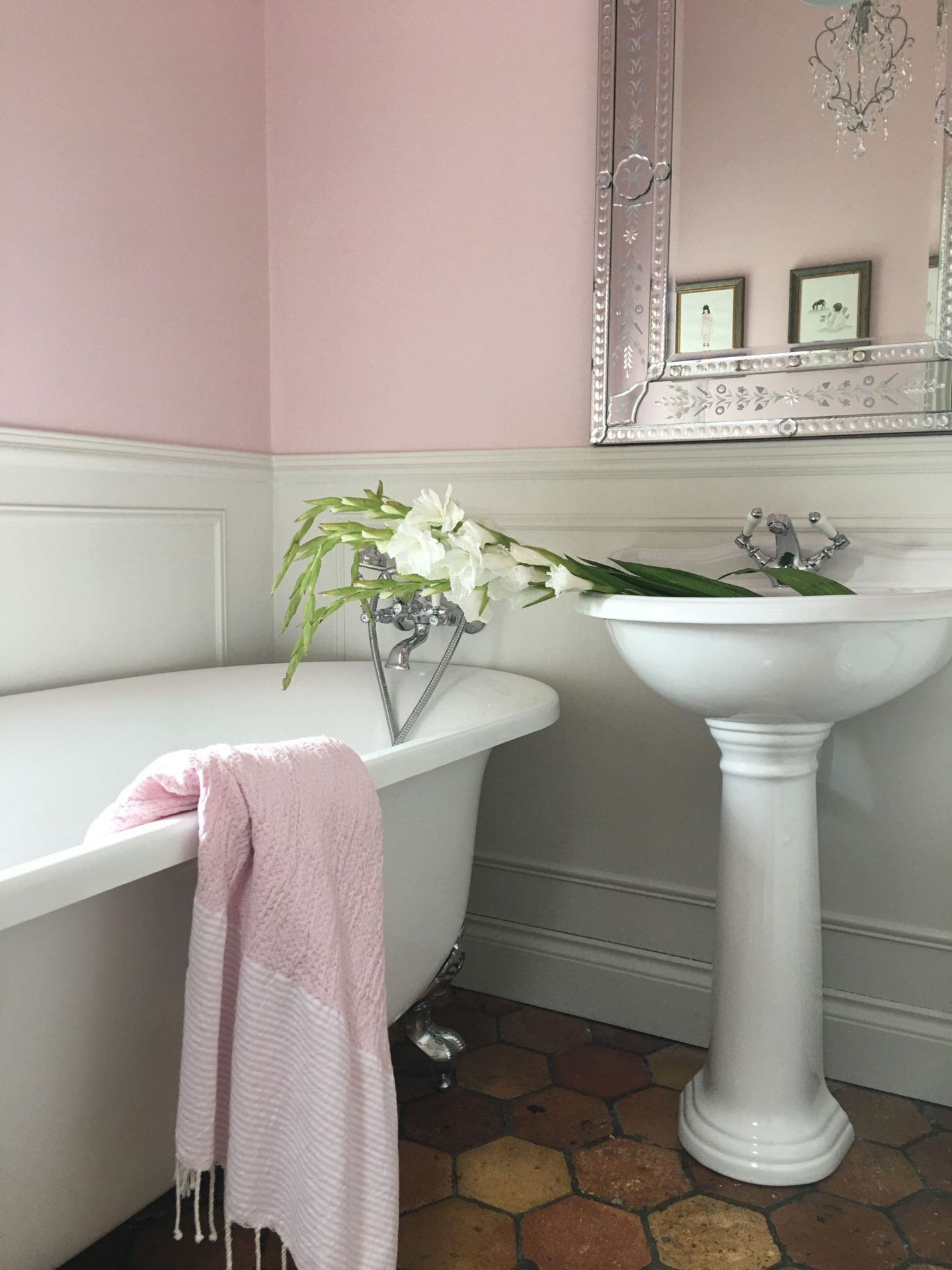 Farrow and Ball Middleton Pink paint color on the walls, a clawfoot tub, and a pedestal sink grace this French farmhouse bathroom with reclaimed terracotta hex tiles - Vivi et Margot.