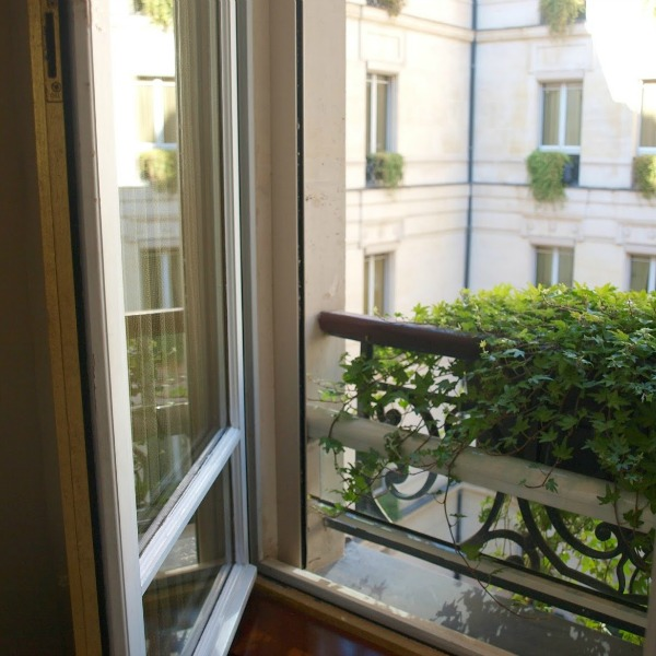 Paris window and ivy spilling out of a window box. #hellolovelystudio #Paris #windowbox #ivy