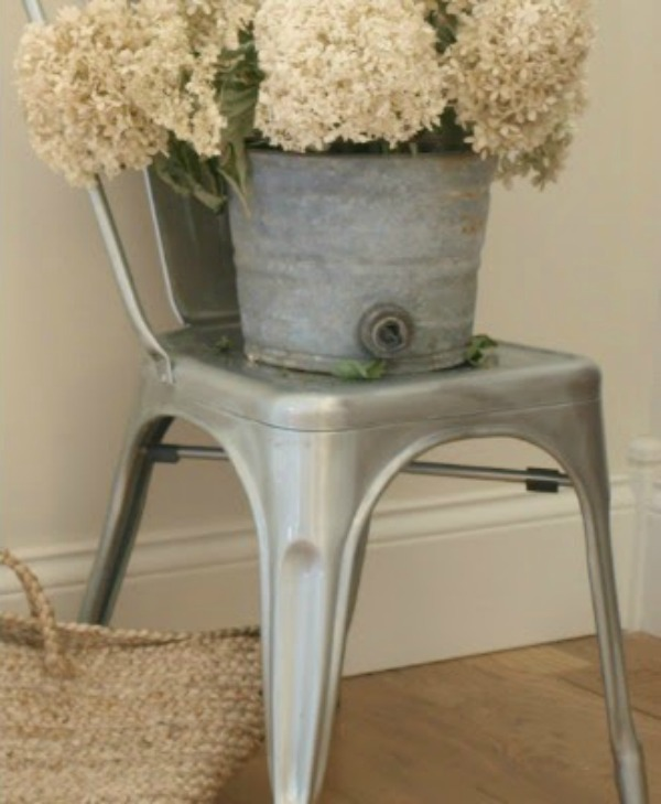 Hydrangea in a vintage bucket upon a French metal chair. Hello Lovely Studio. #shabbychic #hydrangea #frenchfarmhouse #hellolovelystudio