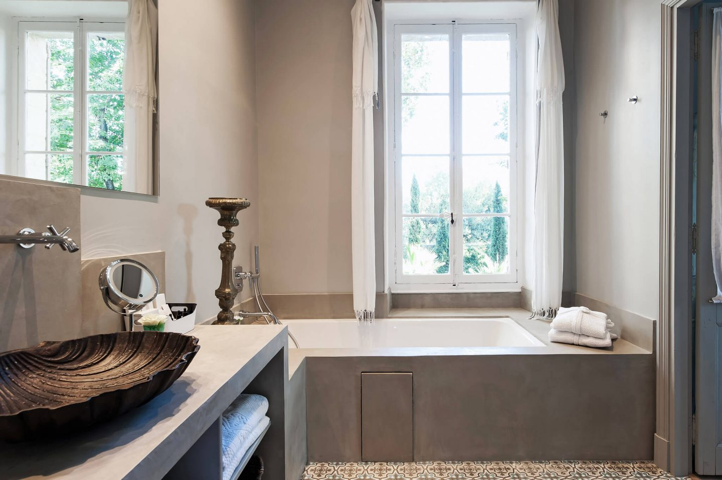 Unique vessel sink in a serene and spare modern French bathroom. Serene French Country Style interior design inspiration. The Serenity Suite at Avignon Hôtel Particulier. Luxurious and timeless restored 19th century French chateau in the South of France. Provencal romance, traditional architecture, modern French design, unique art, and European antiques. Photo: Haven In.