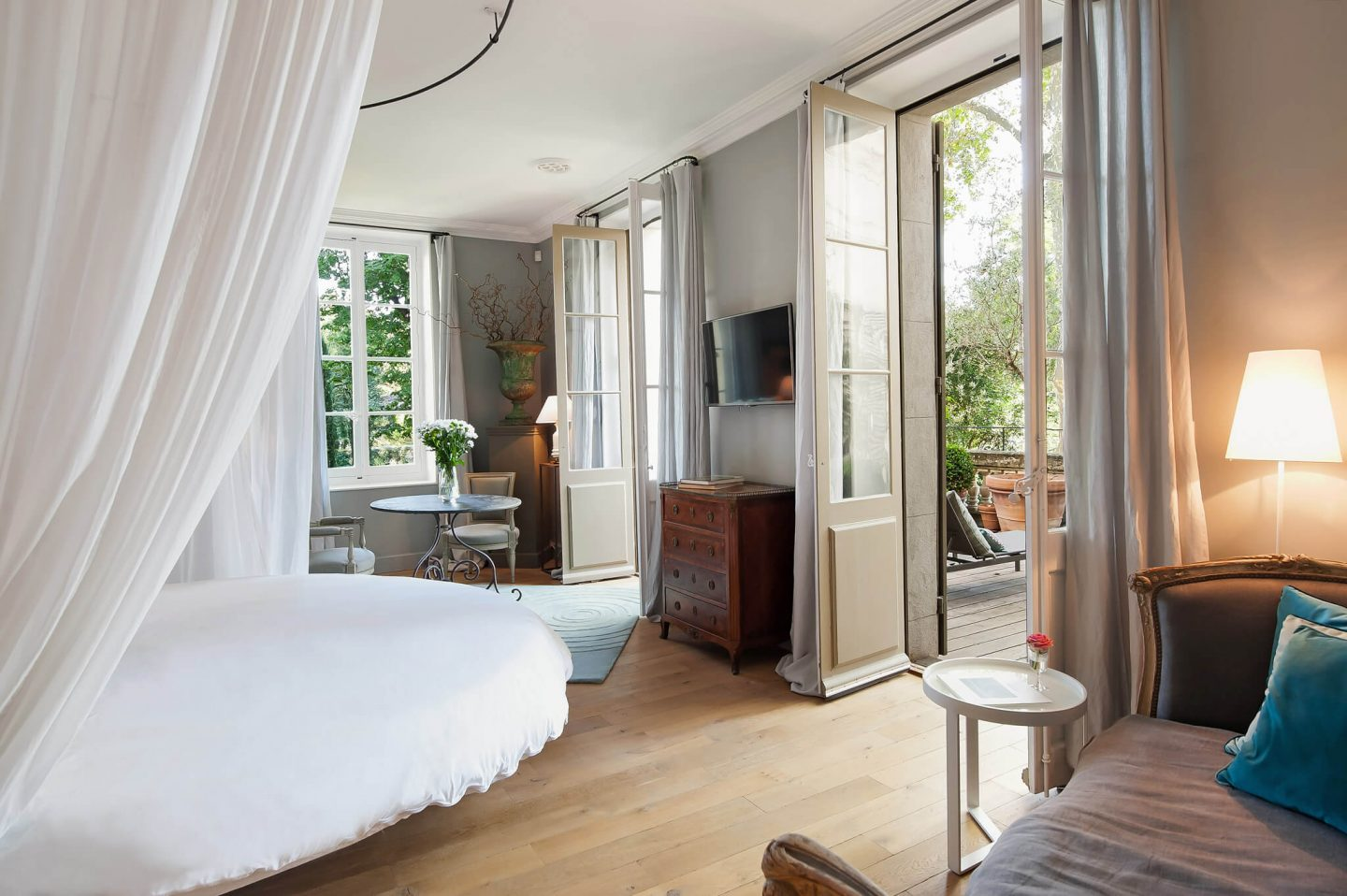 Serene French Country Style interior design inspiration. The Serenity Suite at Avignon Hôtel Particulier. Luxurious and timeless restored 19th century French chateau in the South of France. Provencal romance, traditional architecture, modern French design, unique art, and European antiques. Photo: Haven In.