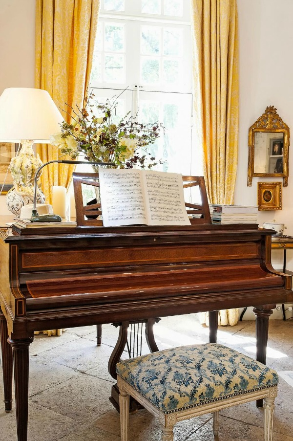 Piano in French country living room. Rustic and elegant: Provençal home, European farmhouse, French farmhouse, and French country design inspiration from Chateau Mireille. Photo: Haven In. South of France 18th century Provence Villa luxury vacation rental near St-Rémy-de-Provence.