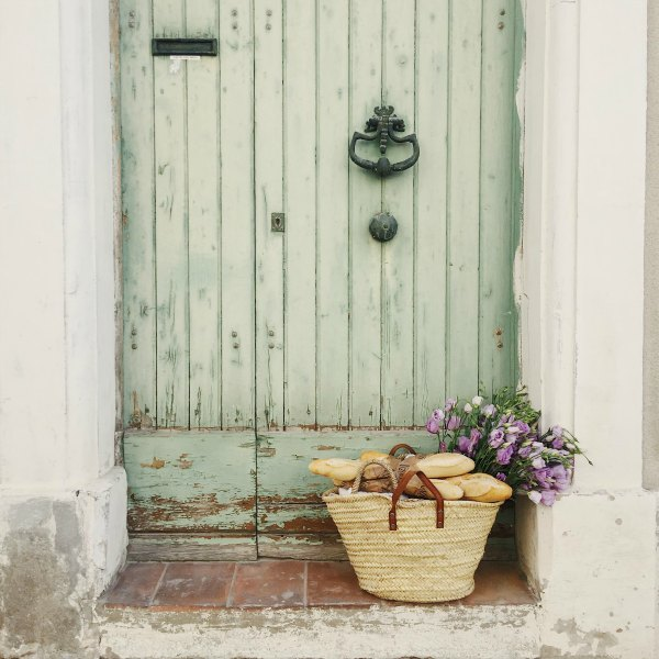 Charming weathered green door! Charming farmhouse in France with French farmhouse design inspiration, house tour, French homewares and market baskets from Vivi et Margot. Get the paint colors and design resources now!