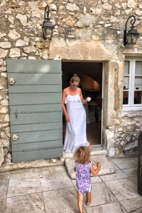 Rustic crumbling stone on a French farmhouse with green door. Vivi et Margot. #frenchfarmhouse #vivietmargot #rustic #stone #exterior #greendoor