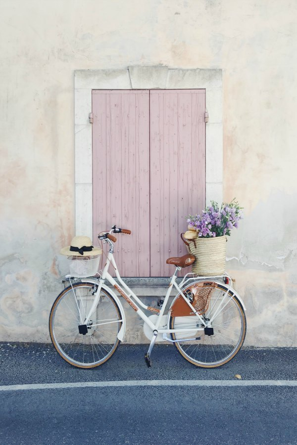 Charming bicycle with French market basket (Vivi et Margot) of flowers and pink shutters on window. Vivi et Margot. Get the paint colors and design resources now!