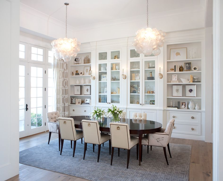 White dining room with lofty ceiling. and French doors. Modern Chic Home in the Southwest. E&A Builders. Pinnacle Conceptions. Jaimee Rose Interiors. #modern #French #housedesign #luxuryhome