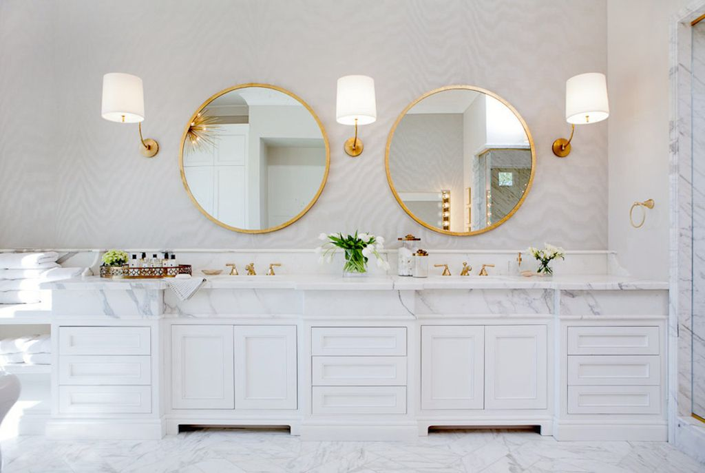 Luxurious white marble double vanity in bathroom with round mirrors. Modern Chic Home in the Southwest. E&A Builders. Pinnacle Conceptions. Jaimee Rose Interiors. #modern #French #housedesign #luxuryhome