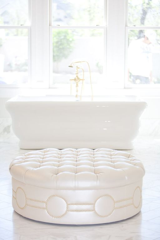 Tufted ottoman and freestanding tub in luxurious white marble bathroom. Modern Chic Home in the Southwest. E&A Builders. Pinnacle Conceptions. Jaimee Rose Interiors. #modern #French #housedesign #luxuryhome