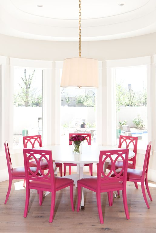 Fuchsia pink dining chairs in breakfast room. Modern Chic Home in the Southwest. E&A Builders. Pinnacle Conceptions. Jaimee Rose Interiors. #modern #French #housedesign #luxuryhome