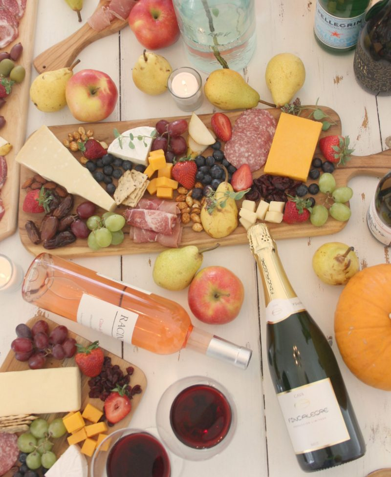 Colorful fall tablescape with cheese boards and wine. Fall leaves and inspiration for savoring the season. Visit 9 Lovely Ways to Savor Autumn Beauty for more beauty from the avenues of Paris to the American prairie. #hellolovelystudio #fallinspiration #autumn #ideas