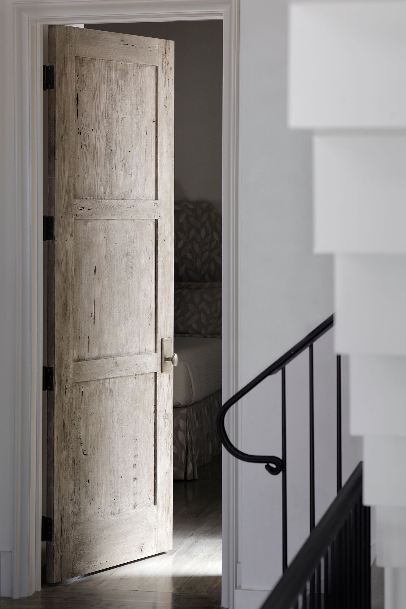 Rustic wood 3-panel door. Stunning interior design and Timeless Architecture Inspiration: Jeffrey Dungan. Photo: William Abranowicz. #classicdesign #traditional #architecture #jeffreydungan #sophisticateddesign #architect