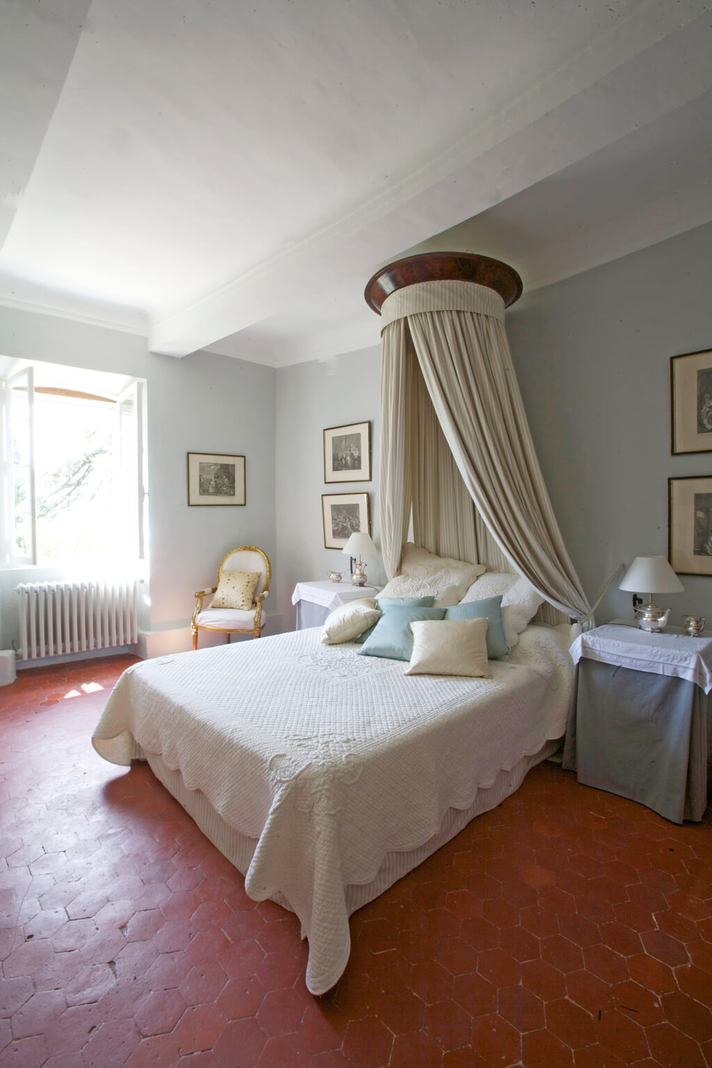 Tranquil blue walls in a French country bedroom.