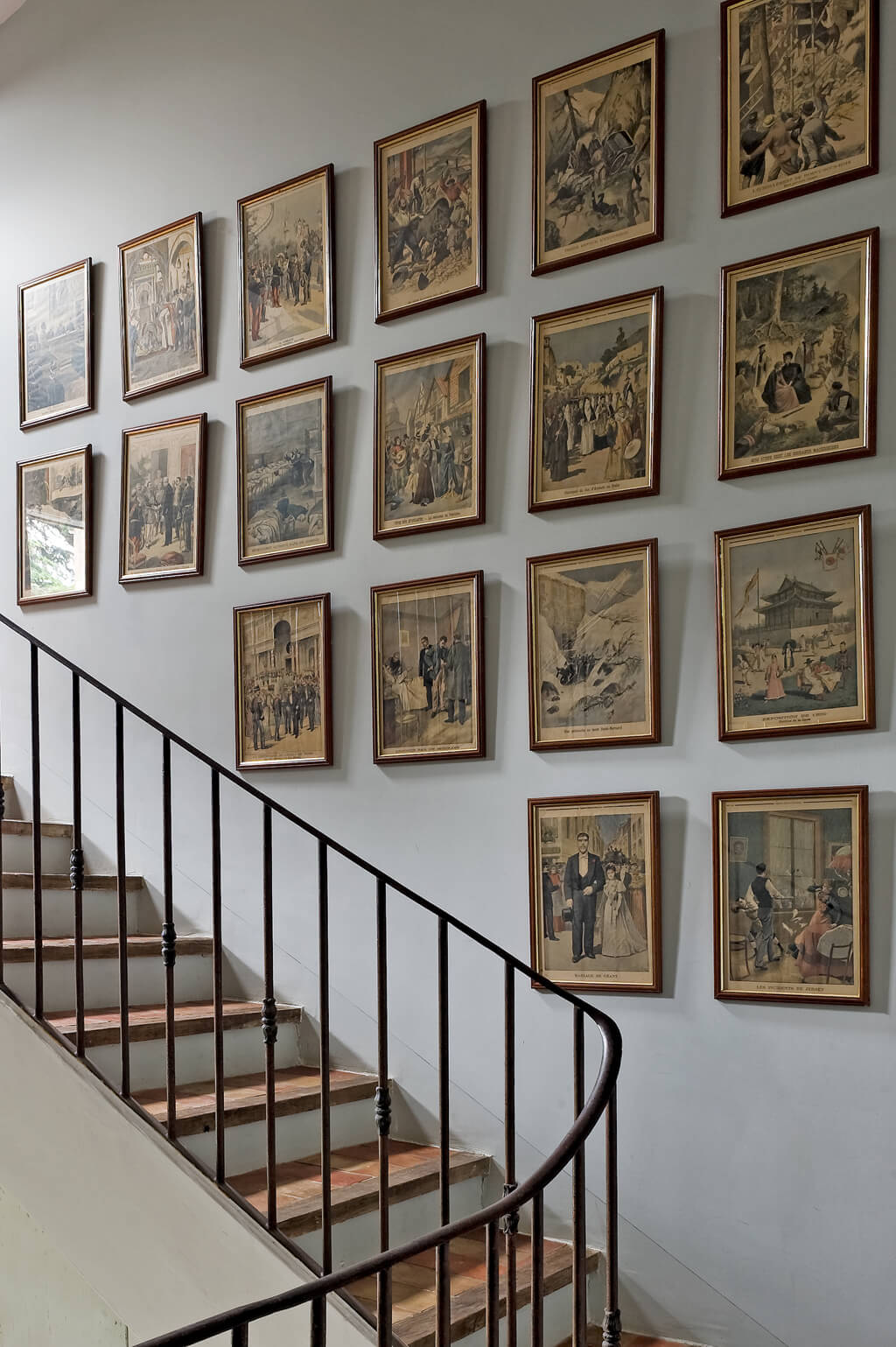 Provence country home with framed etchings massed on staircase wall. Haven In. Villa St-Saturnin. #havenin #provence #frenchcountry #interiordesign #staircase