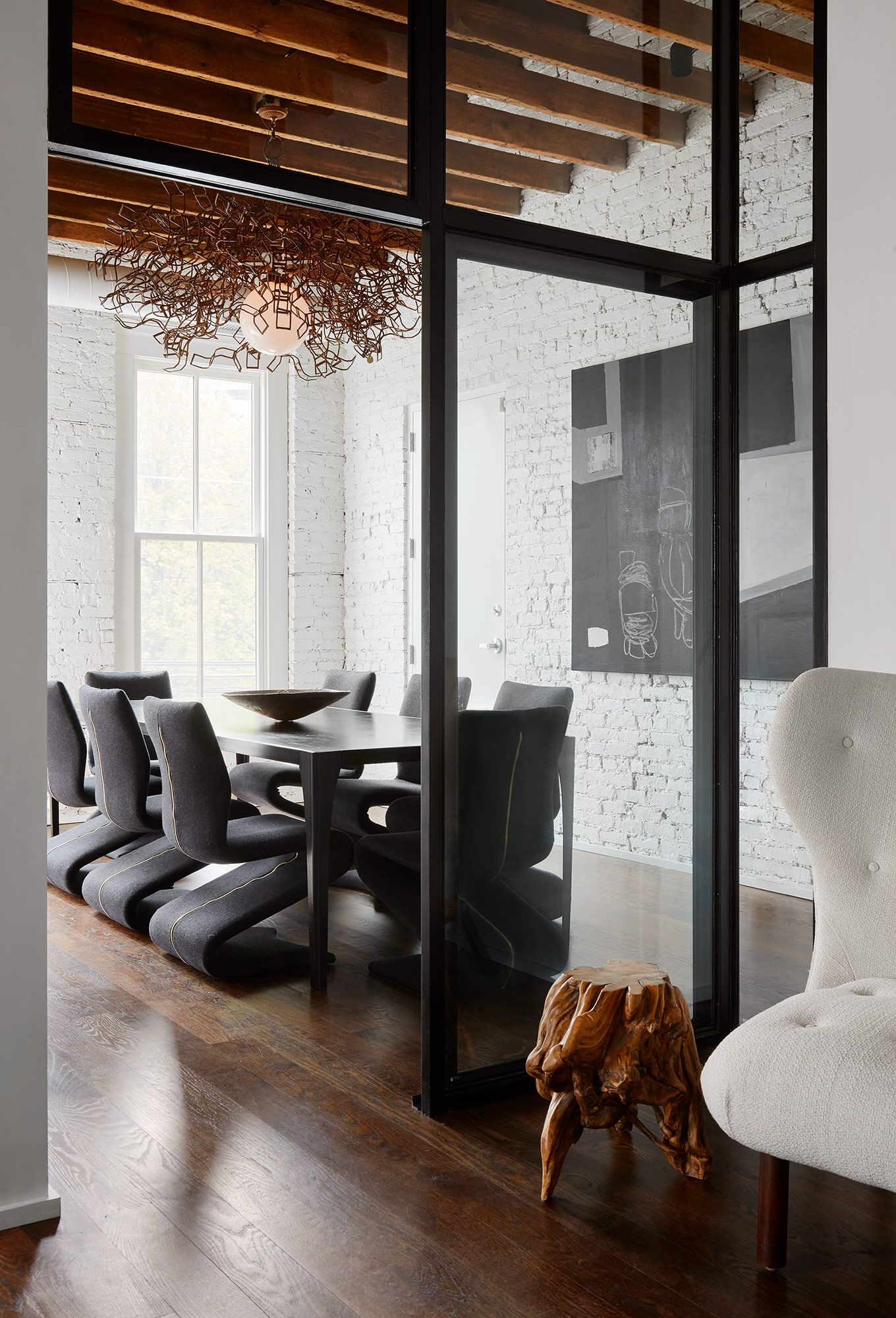 Rustic modern interior design and luxurious minimal modern style in a space by Michael Del Piero. See more Black & White Rustic Modern & Vintage Chic Design Inspo in this story on Hello Lovely.
