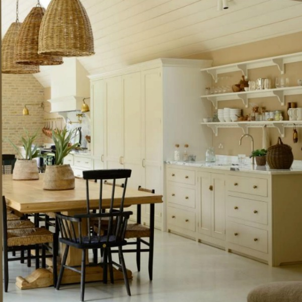 Breathtaking, elegant, and rustic luxe English country kitchen by deVOL kitchens in the UK with bespoke cabinetry, AGA stove, steel windows and doors, woven pendants, and copper accents. Interior design by Susie Atkinson.