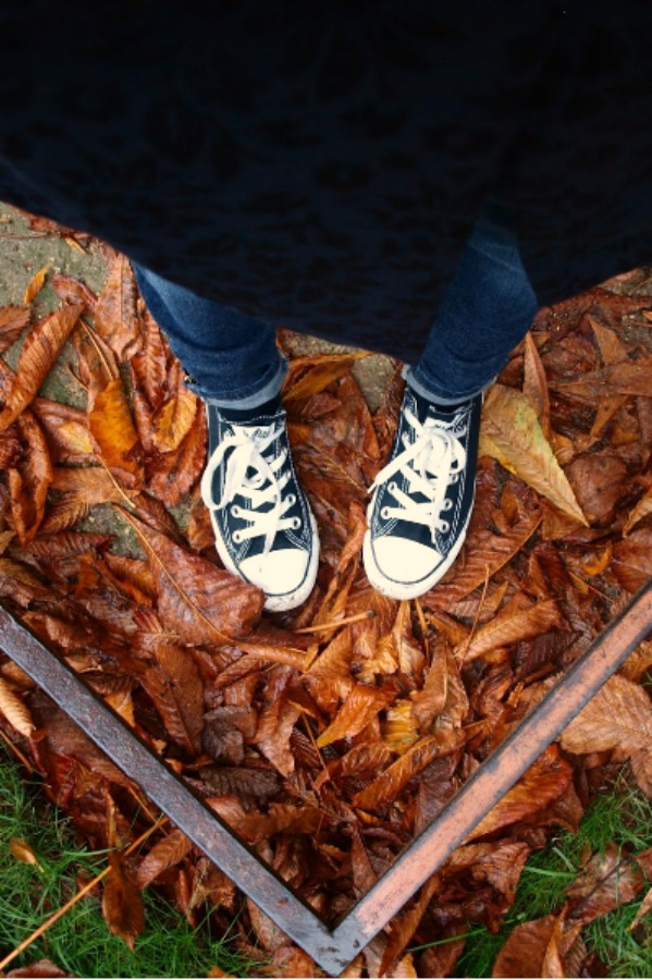 Black converse and red fallen leaves. Fall leaves and inspiration for savoring the season. Visit 9 Lovely Ways to Savor Autumn Beauty for more beauty from the avenues of Paris to the American prairie. #hellolovelystudio #fallinspiration #autumn #ideas