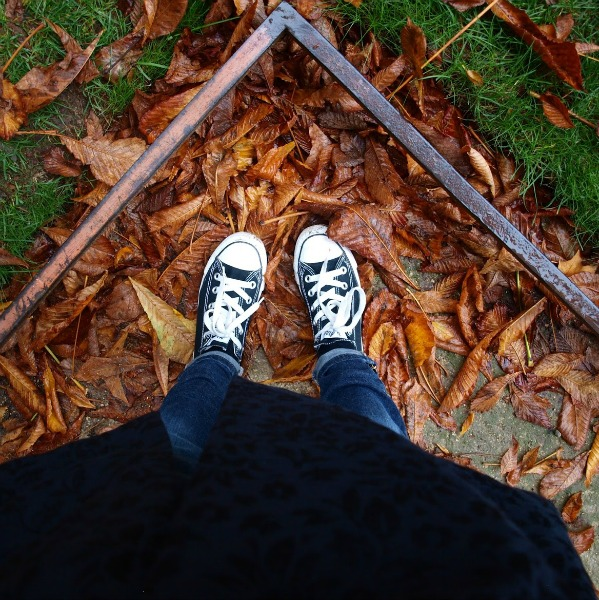 Black converse on russet red leaves in Paris. Fall leaves and inspiration for savoring the season. Visit 9 Lovely Ways to Savor Autumn Beauty for more beauty from the avenues of Paris to the American prairie. #hellolovelystudio #fallinspiration #autumn #ideas