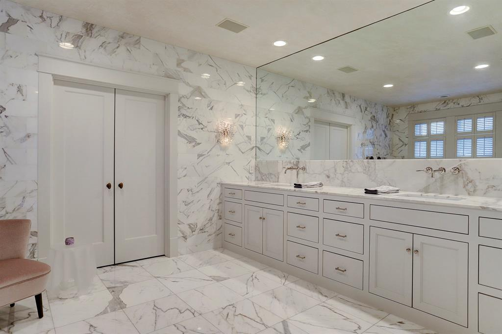 White marble bathroom.Luxurious interior design details in a Tudor Revival house renovation in Houston. Design consultant: Pam Pierce. Many reclaimed antique materials from Chateau Domingue. #housetour #oldworld #pampierce #chateaudomingue #europeanantiques #luxurioushome #interiordesignideas #Frenchcountry #limestone #reclaimedflooring #bespoke #houstonhome