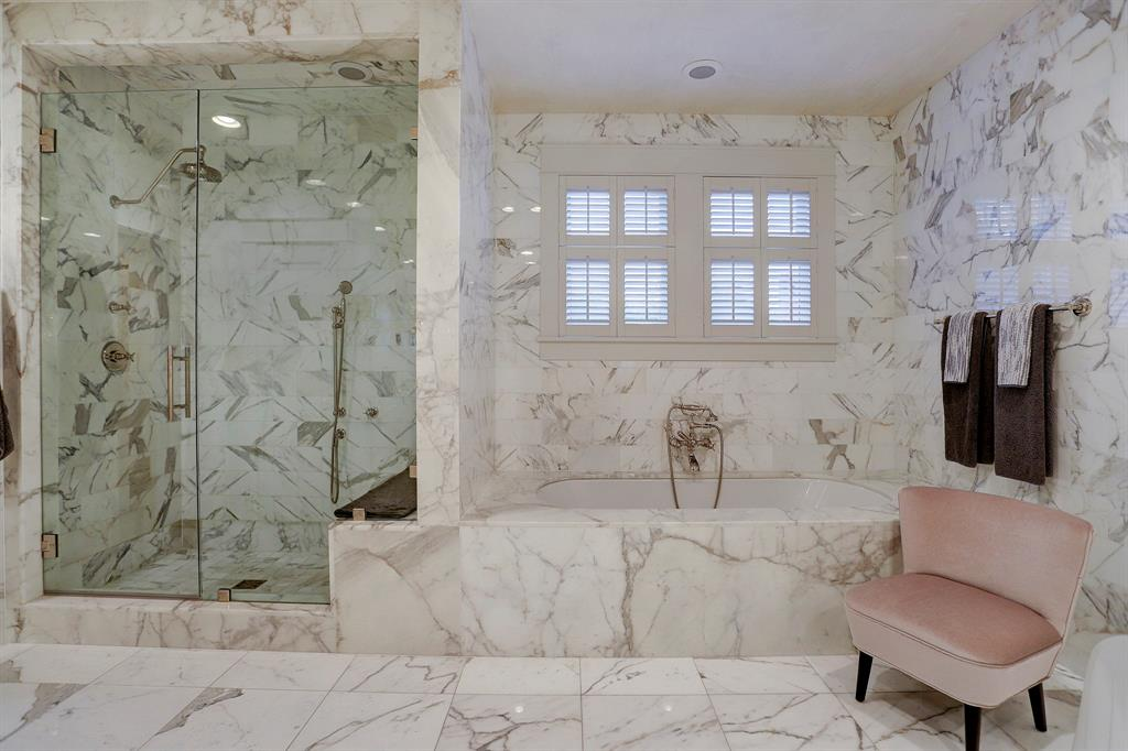 Calacatta marble bathroom. Luxurious interior design details in a Tudor Revival house renovation in Houston. Design consultant: Pam Pierce. Many reclaimed antique materials from Chateau Domingue. #housetour #oldworld #pampierce #chateaudomingue #europeanantiques #luxurioushome #interiordesignideas #Frenchcountry #limestone #reclaimedflooring #bespoke #houstonhome