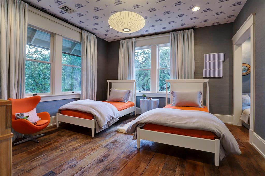 Bright orange accents in a kids bedroom. Luxurious interior design details in a Tudor Revival house renovation in Houston. Design consultant: Pam Pierce. Many reclaimed antique materials from Chateau Domingue. #housetour #oldworld #pampierce #chateaudomingue #europeanantiques #luxurioushome #interiordesignideas #Frenchcountry #limestone #reclaimedflooring #bespoke #houstonhome