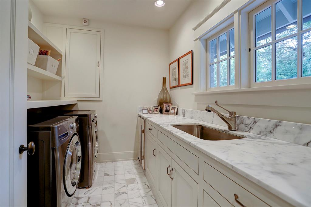 Calacatta marble in laundry room. Luxurious interior design details in a Tudor Revival house renovation in Houston. Design consultant: Pam Pierce. Many reclaimed antique materials from Chateau Domingue. #housetour #oldworld #pampierce #chateaudomingue #europeanantiques #luxurioushome #interiordesignideas #Frenchcountry #limestone #reclaimedflooring #bespoke #houstonhome
