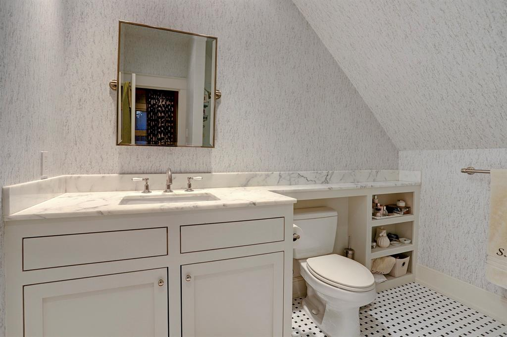 Classic white bathroom. Luxurious interior design details in a Tudor Revival house renovation in Houston. Design consultant: Pam Pierce. Many reclaimed antique materials from Chateau Domingue. #housetour #oldworld #pampierce #chateaudomingue #europeanantiques #luxurioushome #interiordesignideas #Frenchcountry #limestone #reclaimedflooring #bespoke #houstonhome