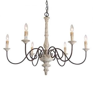 Distressed white French country chandelier adds rustic charm and romantic ambient candle style lighting to your French farmhouse or European country style room.
