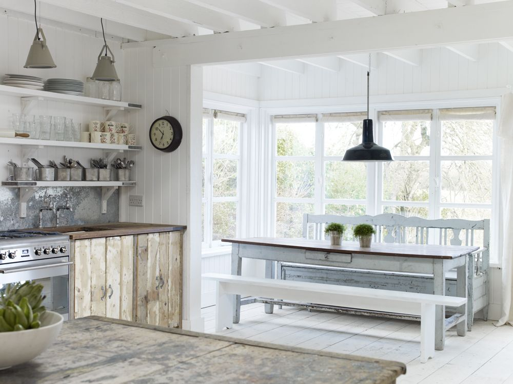 White cottage kitchen withr rustic decor. The Beach Studios. Atlanta Bartlett.
