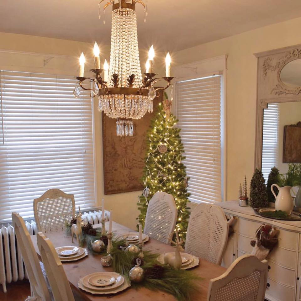 French country Christmas dining room with empire crystal chandelier and European inspired charm. Corner French Cottage. #christmasdecor #shabbychic #frenchfarmhouse #frenchcottage