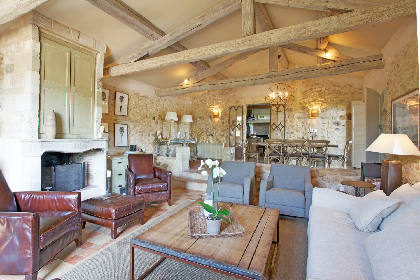 Come discover rustic elegance, ancient stone, and beautiful rugged beams within a Provencal villa - then stay for the paint color and decor Ideas! #frenchcountry #oldworld #interiordesign #provence