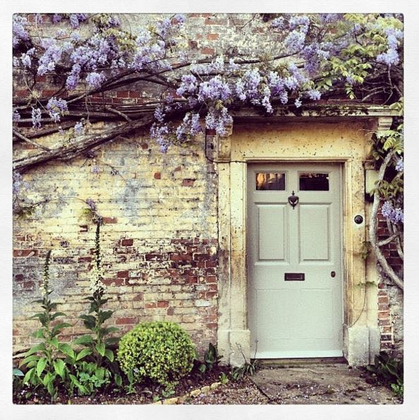 Storybook charm and lovely English country house exterior inspiration describe this lovely cottage exterior and gardens. The Beach Studios. Atlanta Bartlett. #Englishcottage #houseexterior #curbappeal #countryhouse #wisteria #rustic #Europeancountry #Englishcountry #cottagestyle